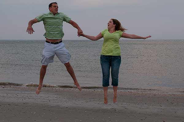Jumping For Joy In Love Engaged Couple