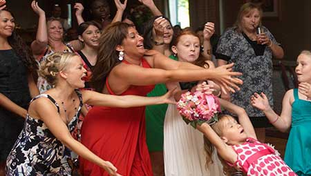 30 Best Bouquet Toss Songs For Your Wedding Playlist