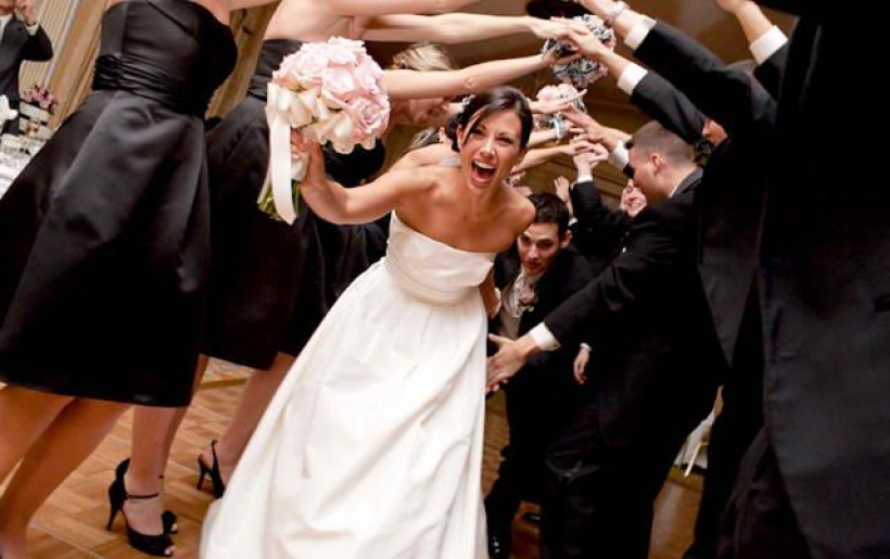 The bridal party introduction is one of the fun times at your wedding reception designed to bring the bridal party into the reception, break the ice, and get the fun started