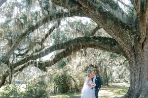Getting married at Magnolia Plantation & Gardens means you'll fall deeper in love underneath the majestic oaks