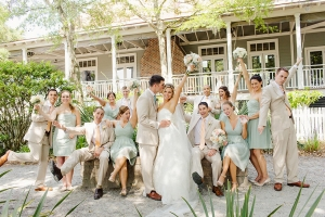 Super fun bridal party pose over at one of Charleston's most beautiful wedding venues | The Creek Club At I'on