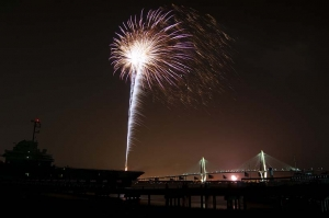Fireworks at Patriots Point on the 4th Of July offer an incredible view of the Charleston harbor and Ravenel Bridge